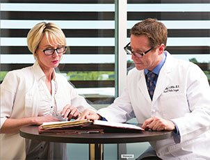 Dr. Miller working with a woman at a table
